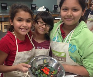 Children in our Seed-to-Plate Nutrition Education™ program at Pine Shadows make  veggie-packed salad.